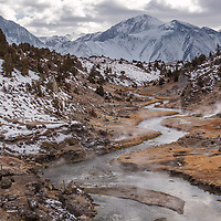 Near Mammoth, California, Hot Creek runs with volcanically heated water, giving off steam and keeping the snows of winter at bay.