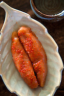 Mentaiko is the marinated roe of pollock, and is considered a delicacy in Japanese cuisine. It is often eaten with onigiri, but is also enjoyed by itself with sake. A common variety is spicy mentaiko, popular in Kyushu especially in Fukuoka.