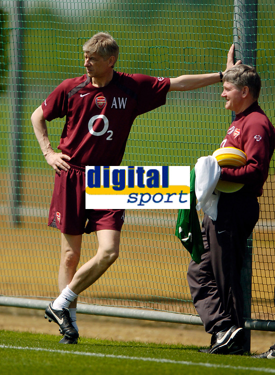 Photo: Richard Lane.<br />Arsenal Training Session. The Barclays Premiership. 11/05/2006.<br />Arsenal manager Arsene Wenger (L) chats with assistant Pat Rice in training.