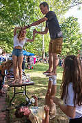Members of Acroyoga Club performs acrobatics during the 2019 Involvement Fair. Photo by Hannah Ruhoff
