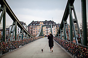 "Germany banned gatherings of more than 2 people called ""social distancing"" because of the coronavirus. The empty ""Eiserner Steg"" (English:Iron footbridge) usually very busy is a footbridge spanning the river Main in the city of Frankfurt, Germany."