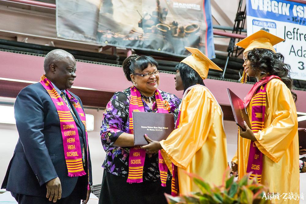 Dr. Sharon A. McCollum shakes the graduates hands as they receive their diplomas.  Ivanna Eudora Kean High School holds its 42nd Annual Commencement Exercise at Digna Marie Wheatley Gymnasium on 13 June 2015.  © Aisha-Zakiya Boyd