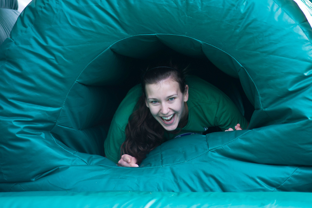 A participant crawls through the inflatable obstacle course during the first part of the O'Bleness Race for a Reason Mud Run, Saturday, April 27, 2013. The course included a four-mile run up to the old Army ROTC Course at the Ridges, through the Radar Hill Trail and back to Tail Great Park across from Peden Stadium. Race for a Reason, Race 4 A Reason, Annual Events, Events, Students, Faculty & Staff