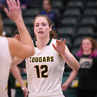 4th year forward Christina McCusker (12) of the Regina Cougars in action during the home opener on November  10 at Centre for Kinesiology, Health and Sport. Credit: Arthur Ward/Arthur Images