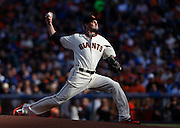 San Francisco Giants starting pitcher Ryan Vogelsong winds up during the first inning of a baseball game against the Los Angeles Dodgers, Saturday, July 26, 2014, in San Francisco. (AP Photo/Beck Diefenbach)