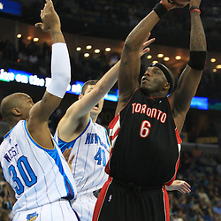 06 February 2009:  Toronto Raptors center Jermaine O'Neal (6) shoots over New Orleans Hornets defenders David West (30) and Ryan Bowen (40) during a NBA game between the New Orleans Hornets and the Toronto Raptors at the New Orleans Arena in New Orleans, LA.
