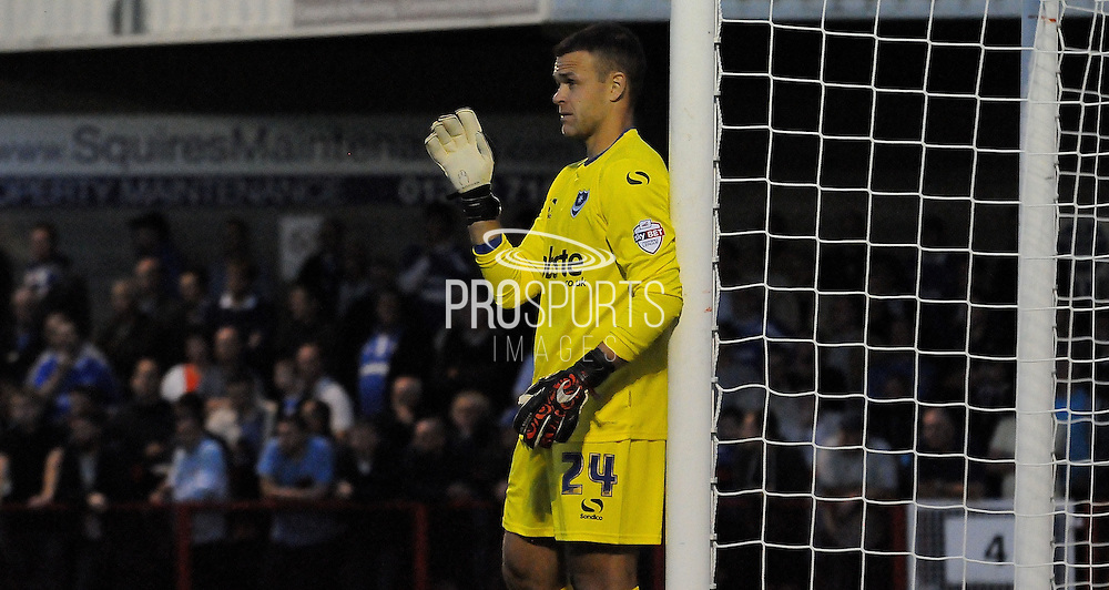 Brian Murphy commands his wall during the Sky Bet League 2 match between Crawley Town and Portsmouth at the Checkatrade.com Stadium, Crawley, England on 18 August 2015. Photo by Michael Hulf.