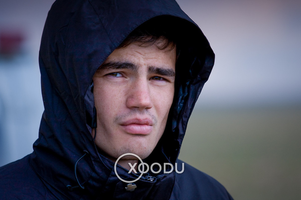 Portrait of serious young man in black hooded jacket (Yas) (, Mongolia - Sep. 2008) (Image ID: 080903-1340241a)