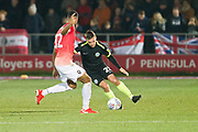 Macclesfield Town defender David Fitzpatrick challenged by Salford City forward Jake Jervis during the EFL Sky Bet League 2 match between Salford City and Macclesfield Town at the Peninsula Stadium, Salford, United Kingdom on 23 November 2019.