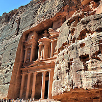 The Treasury Carved into a Cliff in Petra, Jordan <br /> Al-Khazneh is a magnificent example of 1st century Nabataean architecture and the most photographed fa&ccedil;ade in Jordan. The 141 foot tall Treasury was carved into a massive cliff along the valley of Wadi Musa. Some believe this Valley of Moses is near where the prophet miraculously drew water from a rock during the Exodus. The Treasury is also where Harrison Ford sought the Holy Grail during the climax of Indiana Jones and the Last Crusade.