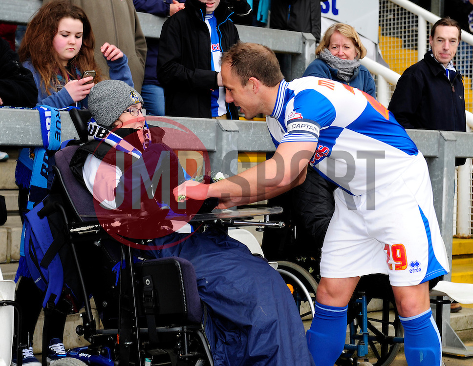 Bristol Rovers' Mark McChrystal gives a Bristol Rovers' fan a flower after the minute silence for the Hillsborough Disaster  - Photo mandatory by-line: Dougie Allward/JMP - Mobile: 07966 386802 12/04/2014 - SPORT - FOOTBALL - Bristol - Memorial Stadium - Bristol Rovers v Torquay United - Sky Bet League Two
