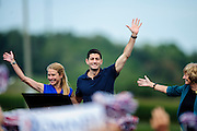 Republican Vice Presidential Candidate Rep. Paul Ryan, flanked by his wife Janna and mother Betty Douglass, greets supporters at the Rockingham County Fairgrounds near Harrisonburg, Virginia on Friday.