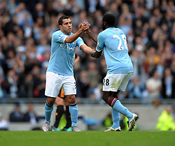 Carlos Tevez hands over the Captain's arm band to team mate Kolo Toure as he is substituted during the Barclays Premier League match between Manchester City and Chelsea at the City of Manchester Stadium on September 25, 2010 in Manchester, England.