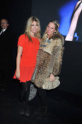Left to right, VIOLET HENDERSON and ALICE DAWSON at a party to celebrate the launch of the new Vertu Constellation phone - the luxury phonemakers first touchscreen handset, held at the Farmiloe Building, St.John Street, Clarkenwell, London on 24th November 2011.