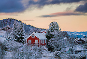 I have taken this photo from Byåsen in Trondheim. I love the combination of all those colors with the Snow.