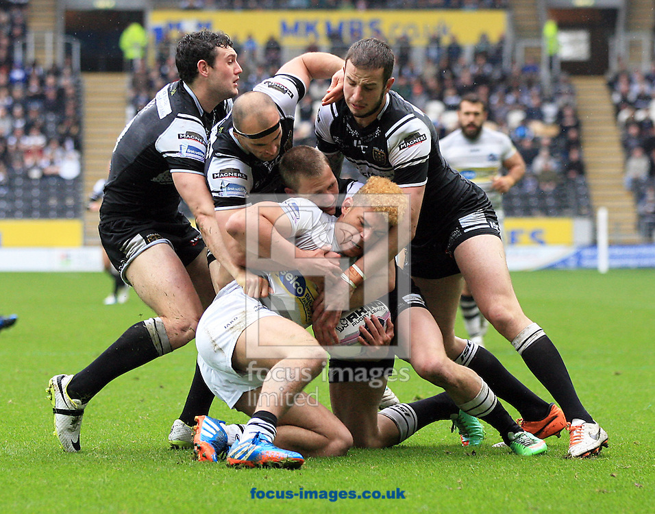 (L2R) Jay Pitts, Danny Houghton, Jacob Miller  &amp; Ben Crooks of Hull Football Club spush back James Woodburn-Hall of London Broncos during the First Utility Super League match at KC Stadium, Hull<br /> Picture by Richard Gould/Focus Images Ltd +44 7855 403186<br /> 21/04/2014