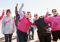 """With the tune """"Sweet Caroline"""" playing this group is feeling SO GOOD~ SO GOOD as they leave Opechee Park during the 2013 Making Strides Against Breast Cancer walk.   (Karen Bobotas/for the Laconia Daily Sun)"""