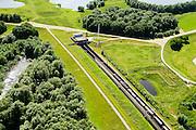 Nederland, Gelderland, Duiven, 09-06-2016; Groessen, natuurgebied Kandia. Goederentrein op Betuweroute nadert de tunnel onder Pannerdens kanaal. Dienstgebouw van de tunnel onder het Pannerdensch kanaal.<br /> Tunnel Betuweroute, freight railway, Pannerdensch channel (Lower Rhine) on the horizon.<br /> <br /> luchtfoto (toeslag op standard tarieven);<br /> aerial photo (additional fee required);<br /> copyright foto/photo Siebe Swart