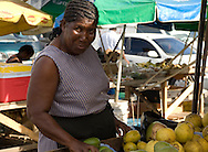 A woman selling mangos in the market in Castries, St Lucia, The Windward Islands,<br /> The Caribbean