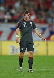 NOVI SAD, SERBIA - Tuesday, September 11, 2012: Wales' Gareth Bale looks dejected as his side lose 2-1 to Serbia during the 2014 FIFA World Cup Brazil Qualifying Group A match at the Karadorde Stadium. (Pic by David Rawcliffe/Propaganda)