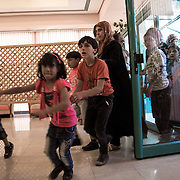 Finally the doors of the Hebron theather open, the children rush to occupy their seats, ready for Mobile Circus show