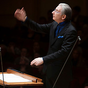 """March 27, 2012 - New York, NY : Music Director and Conductor Michael Tilson Thomas, on podium, leads the San Francisco Symphony in Henry Cowell's """"Synchrony (1930)"""" in Carnegie Hall's Stern Auditorium on Tuesday evening.  CREDIT : Karsten Moran for The New York Times"""