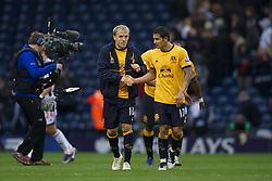 WEST BROMWICH, ENGLAND - Sunday, January 1, 2011: Everton's captain Phil Neville and Tim Cahill after the 1-0 win over West Bromwich Albion during the Premiership match at the Hawthorns. (Pic by David Rawcliffe/Propaganda)
