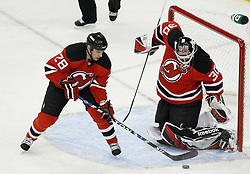 Apr 15, 2009; Newark, NJ, USA; New Jersey Devils defenseman Niclas Havelid (28) clears the rebound after a save by New Jersey Devils goalie Martin Brodeur (30) during the first period of game one of the eastern conference quarterfinals of the 2009 Stanley Cup playoffs at the Prudential Center.