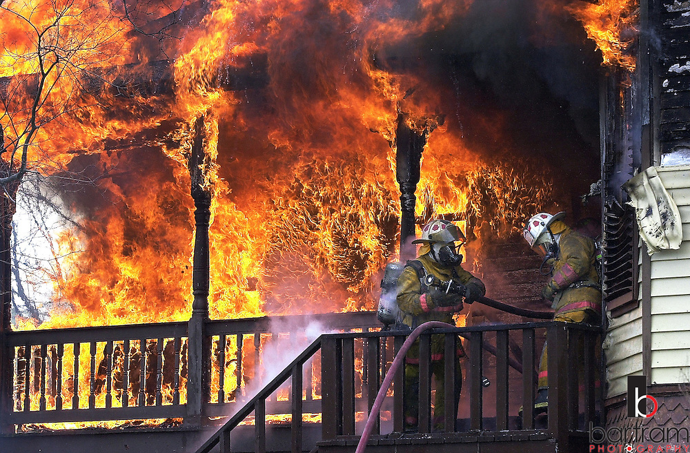 Galveton, Texas firefighters battle a house fire in the 3500 block of Avenue O. The home was a total loss.