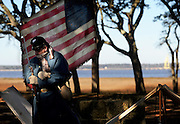 "A civil war re-enactor stands at attention at North Carolina's Fort Fisher during their reenactment of the ""Battle of Fort Fisher"" on a cold January morning."