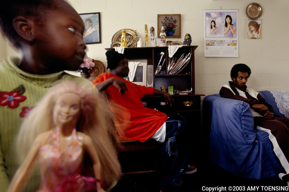 PORTLAND, ME- APRIL 01: A young Muslim girl plays with her Barbie doll April 1, 2004 in Portland, Maine. Muslim females in the United States straddle two cultures, as they are expected to uphold many of the customs and traditions of Islam in the face of western culture. (Photo by Amy Toensing). _________________________________<br />