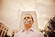 ORLANDO, FL - JULY 7:  A heart lies at the center of the taped mouth of Edward Mehnert, 26, in sympathy for Caylee Anthony the dead daughter of Casey Anthony, on the day Casey is sentenced for lying to law enforcement in Orlando. (Photo by Roberto Gonzalez