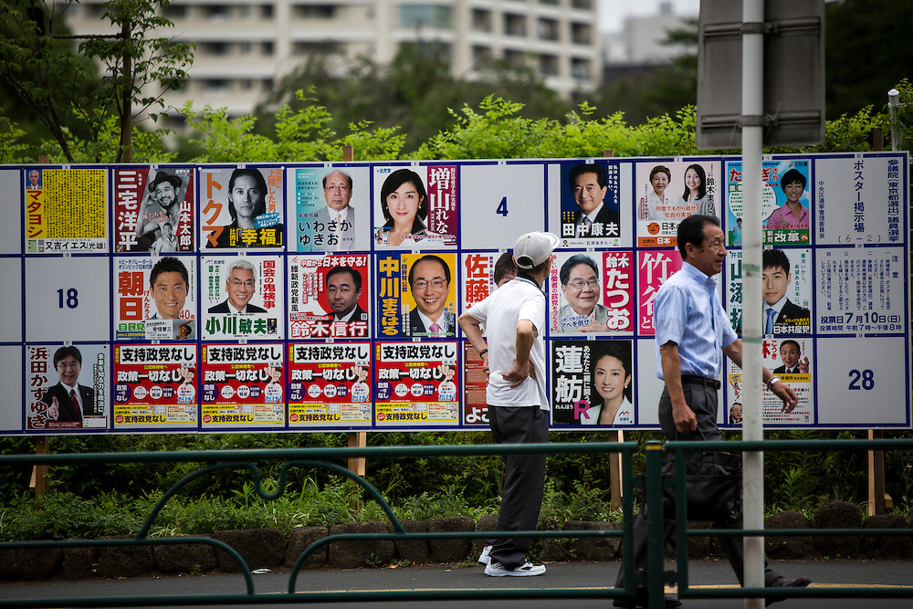 TOKYO, JAPAN - JULY 05 : A man look at campaign posters with pictures of candidates for the 2016 Upper House election in Tokyo, Japan, on Tuesday, July 5, 2016. Japanese voters will fill in their ballots next week, July 10, 2016 for the Upper House election. (Photo by Richard Atrero de Guzman/NurPhoto)