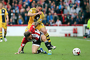 Fulham defender, Ashley (Jazz) Richards (02) battling for ball with Brentford midfielder, Sam Saunders (7) during the Sky Bet Championship match between Brentford and Fulham at Griffin Park, London, England on 30 April 2016. Photo by Matthew Redman.
