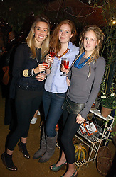 Left to right, MELISSA MILLS, LUCYBELLE MULLEN and LARA BOGLIONE at a party to celebrate the publication on 'A Year in My Kitchen' by Skye Gyngell held at The Petersham Nurseries, Petesham, Surrey on 19th October 2006.<br /><br />NON EXCLUSIVE - WORLD RIGHTS