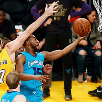 28 February 2017: Charlotte Hornets guard Kemba Walker (15) goes for the layup past Los Angeles Lakers forward Larry Nance Jr. (7) during the Charlotte Hornets 109-104 victory over the LA Lakers, at the Staples Center, Los Angeles, California, USA.