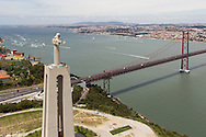 PORTUGAL, Lisbon. 9th June 2012. Volvo Ocean Race, Oeiras In-Port Race. Christ the King statue, with the 25th of April Bridge over the Tejo river.