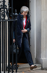 © Licensed to London News Pictures. 29/10/2018. London, UK. British Prime Minister Theresa May leaves 10 Downing Street moments before Chancellor of the Exchequer Philip Hammond (not pictured) holds his red ministerial box outside 11 Downing Street as part of a photocall on the autumn budget statement day. Photo credit : Tom Nicholson/LNP