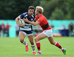Bristol Rugby Inside Centre Ben Mosses is challenged by London Welsh Fly-Half Joe Carlisle - Mandatory byline: Dougie Allward/JMP - 07966 386802 - 13/09/2015 - RUGBY UNION - Old Deer Park - Richmond, London, England - London Welsh v Bristol Rugby - Greene King IPA Championship.