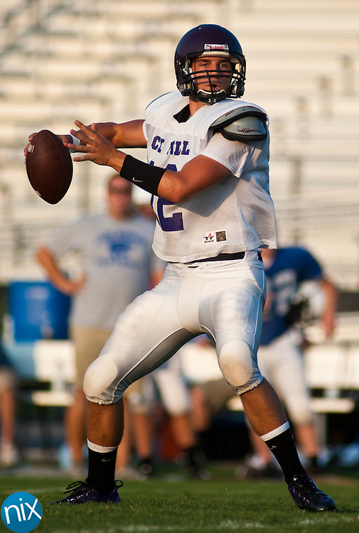 Cox Mill quarterback Aarrick Hincher passes the pall during a scrimmage against Lake Norman at Cox Mill High School in Concord Friday night. (photo by James NIx)