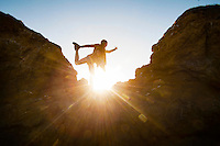 Happy casual yoga woman high on a cliff.<br /> +++<br /> &quot;One love, one heart, one destiny.&rdquo; ― Bob Marley