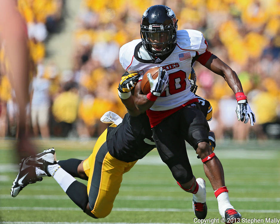 August 31 2013: Northern Illinois Huskies wide receiver Tommylee Lewis (10) tries to pull away from Iowa Hawkeyes linebacker Anthony Hitchens (31) during the first quarter of the NCAA football game between the Northern Illinois Huskies and the Iowa Hawkeyes at Kinnick Stadium in Iowa City, Iowa on August 31, 2013. Northern Illinois defeated Iowa 30-27.