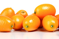 Kumquat on white background - close-up