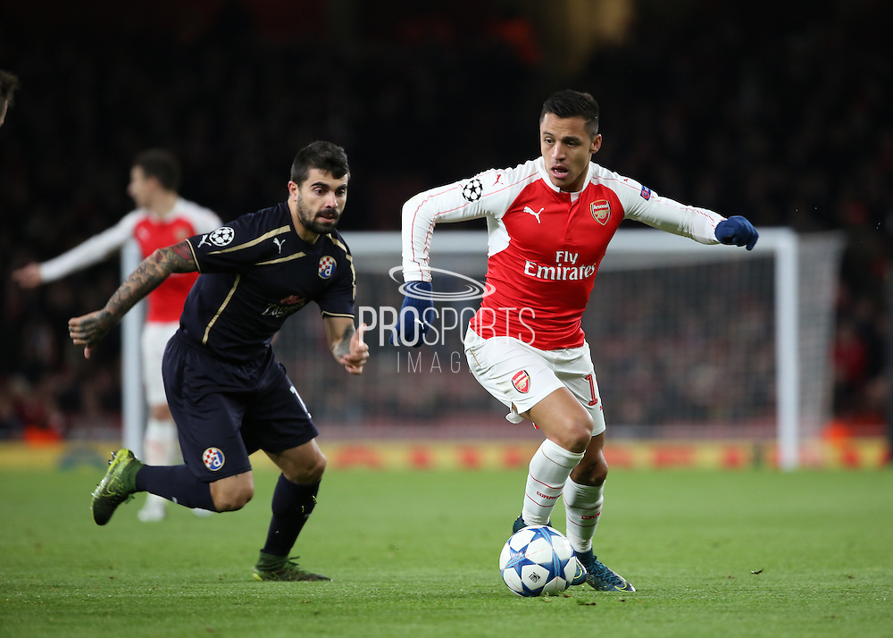 Arsenal striker Alexis Sanchez launching another Arsenal attack during the Champions League match between Arsenal and Dinamo Zagreb at the Emirates Stadium, London, England on 24 November 2015. Photo by Matthew Redman.