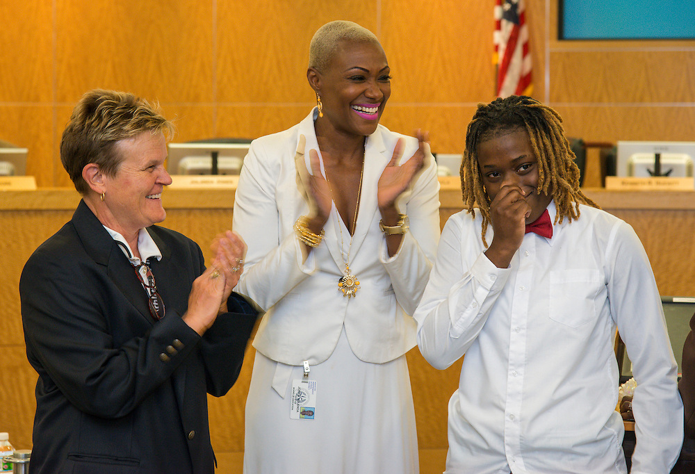 Marmion Dambrino and Trustee Jolanda Jones congratulate Brandolyn Walker during a meeting of the Board of Trustees, June 9, 2016.