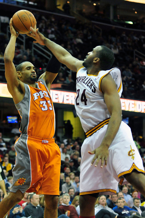 Jan. 19, 2011; Cleveland, OH, USA; Phoenix Suns small forward Grant Hill (33) grabs a rebound over Cleveland Cavaliers power forward Samardo Samuels (24) during the third quarter at Quicken Loans Arena. The Suns beat the Cavaliers 106-98. Mandatory Credit: Jason Miller-US PRESSWIRE