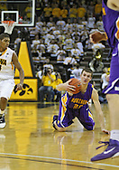 December 07 2010: Northern Iowa Panthers forward Jake Koch (20) tries to keep control of the ball as Iowa Hawkeyes guard/forward Roy Devyn Marble (4) looks on during the first half of their NCAA basketball game at Carver-Hawkeye Arena in Iowa City, Iowa on December 7, 2010. Iowa defeated Northern Iowa 51-39.