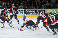 KELOWNA, CANADA - JANUARY 10: Colten Martin #8 of Kelowna Rockets back passes the puck against the Medicine Hat Tigers on January 10, 2015 at Prospera Place in Kelowna, British Columbia, Canada.  (Photo by Marissa Baecker/Shoot the Breeze)  *** Local Caption *** Colten Martin;