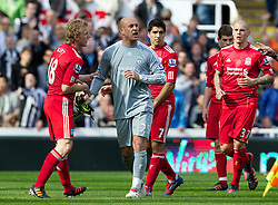 NEWCASTLE-UPON-TYNE, ENGLAND - Sunday, April 1, 2012: Liverpool's goalkeeper Jose Reina walks dejected off the pitch after being sent off as team-mates Dirk Kuyt and Luis Alberto Suarez Diaz try to calm him down during the Premiership match against Newcastle United at St James' Park. (Pic by Vegard Grott/Propaganda)