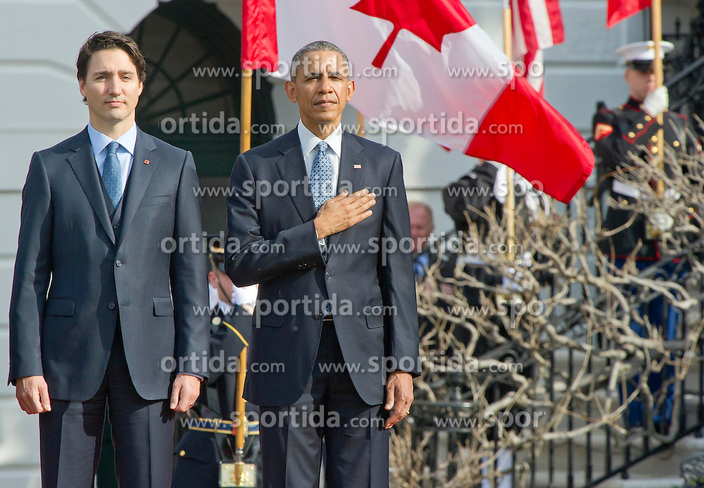 United States President Barack Obama, right, and Prime Minister Justin Trudeau of Canada, left, listen to the National Anthems during an Arrival Ceremony on the South Lawn of the White House in Washington, DC on Thursday, March 10, 2016. EXPA Pictures &copy; 2016, PhotoCredit: EXPA/ Photoshot/ Ron Sachs<br /> <br /> *****ATTENTION - for AUT, SLO, CRO, SRB, BIH, MAZ, SUI only*****